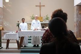 Deacon Roshan Kiro SJ assists Fr J.P. Horrigan SJ at the memorial Mass for Fr Joe Brennan SJ. (Photo: CJI)