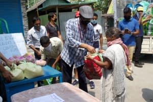 Fr-Lalit-handing-out-food-items